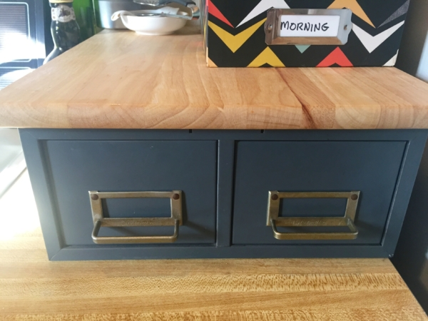 Vintage metal catalog drawers in the kitchen